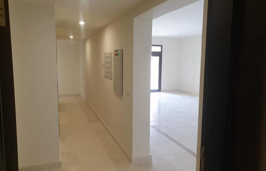 apartment for rent in mivida with AC,S & kitchen