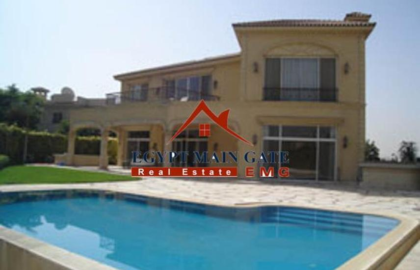 Villa for sale with a lovely garden and pool .